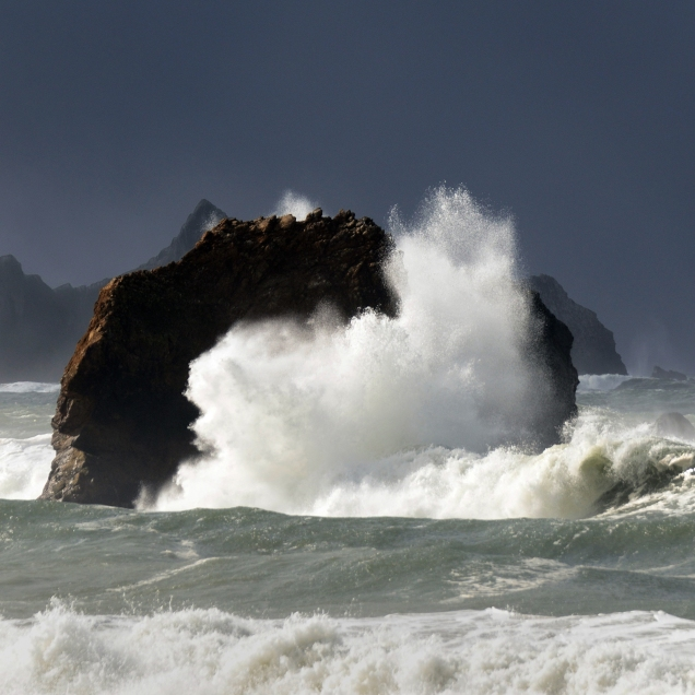 """Even on a gray day a splash of sunshine can brighten the moment with a vivid """"boom"""" of crashing surf."""